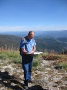 Long-time Committee member, Jim Fazio, reads about the the Expedition from a vantage point on the Lolo Trail.