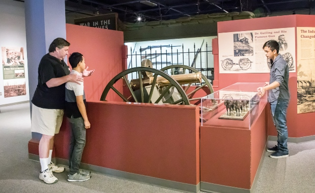 Family and Gatling Gun in Earl Exhibit